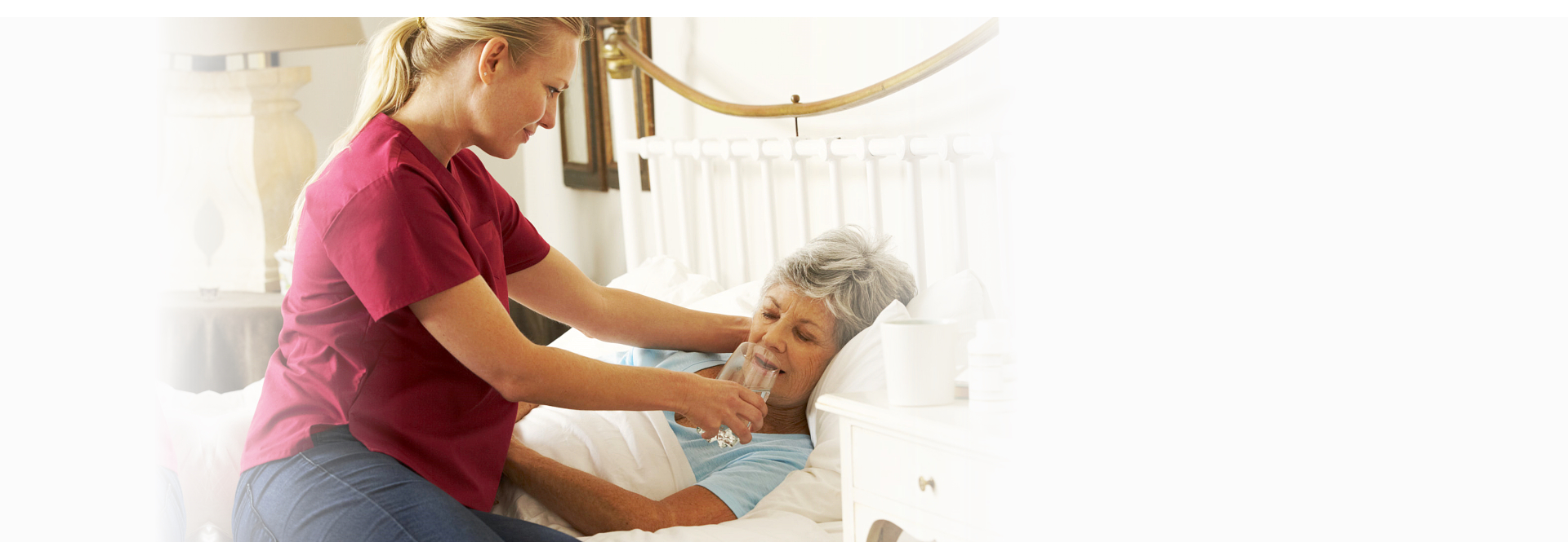 caregiver helping her patient in drinking